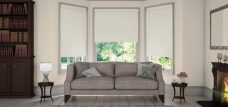 Three Diffusion-cashmere-sheer-roller blinds in a lounge