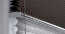 A Duette Bear Blackout Blinds 64 mm - Two different fabrics hung on the same headrail