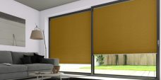 Two Duette Classic Caribou Blackout Blinds in a lounge