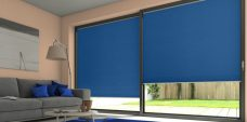 Two Duette Classic Cloud Blue Blackout Blinds in a lounge setting