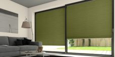 Two Duette Classic Spanish Moss Blackout Blinds set in a lounge
