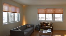 Two Duette Classic Caramel Crisp Duo Tone Blinds set in a living room