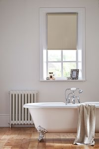 Midnight-fr-blackout-beige-roller blinds in a bathroom