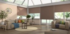 Four Rianna Duo Hazelnut Senses Roller Blinds set in a conservatory