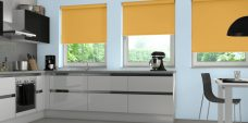 Three Rianna Duo Mustard Blackout Roller Blinds in a kitchen