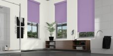 Three rianna-violet-roller blinds in a bathroom