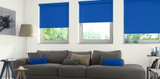 Three Solare Pitch Blue blinds in a lounge