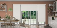 Three Solare Winter White Blackout Senses Roller Blinds fitted in a kitchen