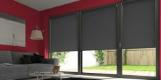 Three Palette Black Senses Roller Blinds fitted in a lounge