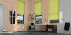 Three Palette Fresh Apple Motorised Roller Blinds fitted in a bathroom