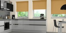 Three Spritzer Gold Senses Roller Blinds fitted in a kitchen