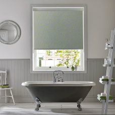Squiggle Lime Senses Roller Blind fitted in a bathroom