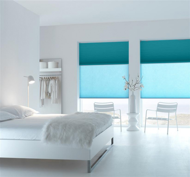 Unix Aquamarine Blackout Blinds in a bedroom top section