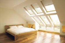 Velux-1085-light-beige blinds in a loft bedroom