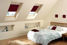 Velux-4560-dark-red blinds in a bedroom