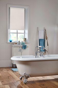 Waterfall Cream Roller Blind in a bathroom