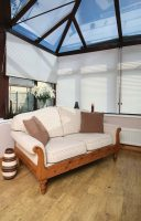 Altitude Vanilla Mist Pleated Blinds in a conservatory