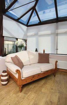 Crush Vanilla Pleated Blinds in a conservatory
