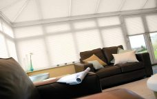 Nine Altitude Vanilla Solar Reflective Roof Blinds in a conservatory
