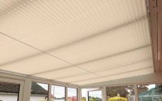 Seven Crush Biscuit Solar Reflective Roof Blinds in a conservatory