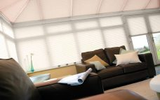 10 Crush Hazel Solar Reflective Roof Blinds in a conservatory