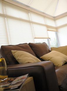 Crush Natural Pleated Blinds in a conservatory