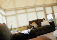 Crush Sorbet Pleated Blinds in a conservatory