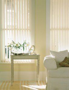 Josephine Cream Vertical Blinds in a lounge