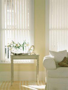 Josephine White Vertical blinds in a lounge