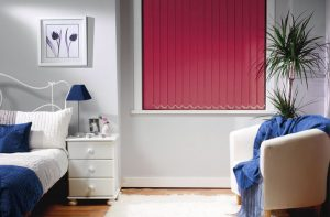 Lunar Red Vertical Blinds in a bedroom