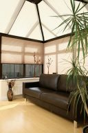 Marcello Clementine Pleated Blinds in a conservatory