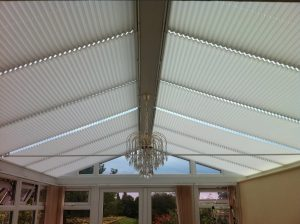 Twelve Marcello Old Lace solar reflective pleated roof blinds in a conservatory