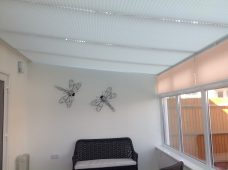Four Marcello Silver Grey solar reflective pleated roof blinds in a conservatory