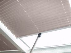 Two Oklahoma solar reflective bronze pleated roof blinds