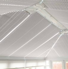Twelve Oklahoma Flashlight Solar Reflective Roof Blinds in a conservatory