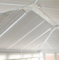 Twelve Oklahoma Pearl Solar Reflective Roof Blinds in a conservatory