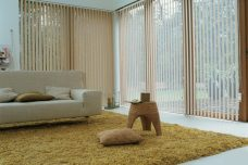 Rianna Duo Clay Vertical blinds in a sun room