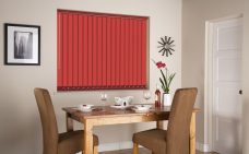 Rianna Duo Signal Red Vertical Blind in a dining room