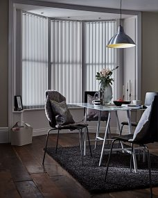 Vegas Sparkle Vertical blinds in a dining room