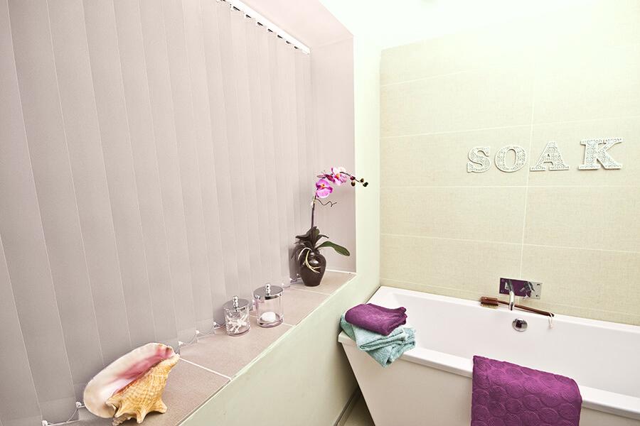 Polaris Rose vertical blind in a bathroom
